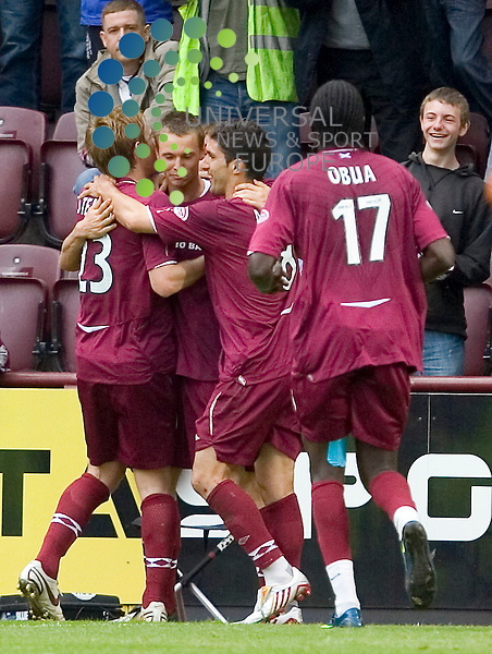 Heart of Midlothian v Dundee Utd., Tynecastle, Edinburgh - 16/05/2009.Scottish Premier League League 2008/09..Hearts' Eggert Jónsson is congratulated by his team mates after scoring from the spot.    Picture by John Cockburn/ Universal News & Sport (Scotland)