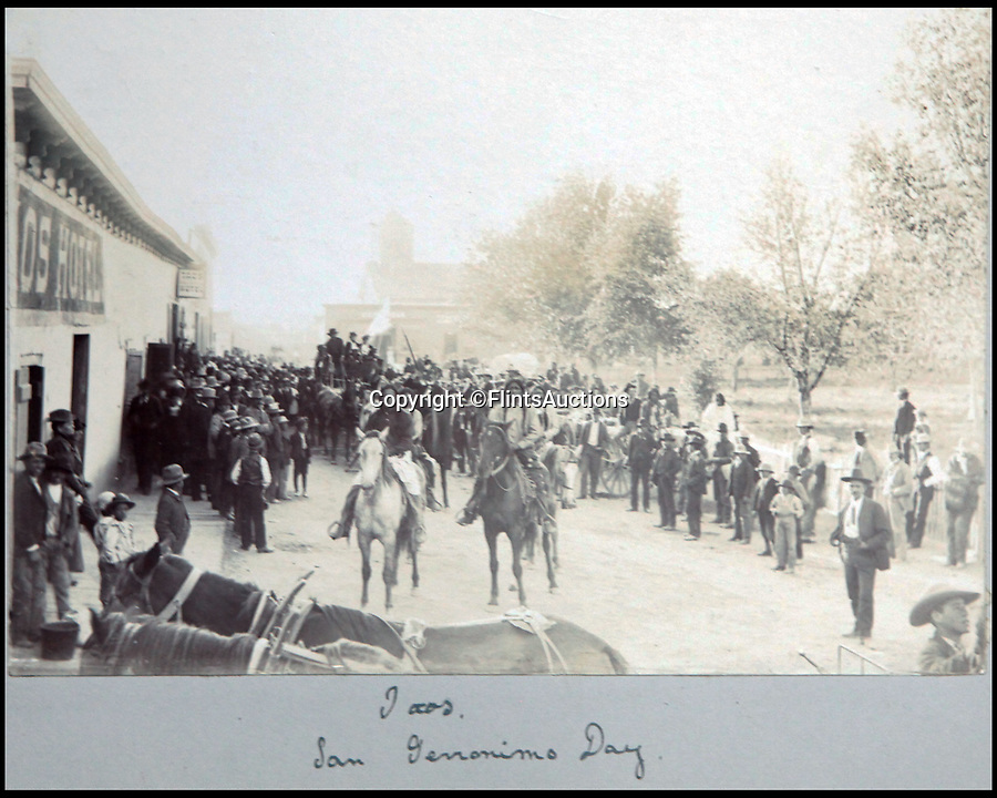 BNPS.co.uk (01202 558833)<br /> Pic: FlintsAuctions/BNPS<br /> <br /> 'San Geromnimo Day' in the Taos Pueblo near Santa Fe, New Mexico.<br /> <br /> Unseen album reveals the life of a cowboy in the real wild west...<br /> <br /> Fascinating previously unseen early photos of cowboys in the Wild West have come to light 130 years later.<br /> <br /> They show life on the ranches of Colorado and New Mexico in the vast expanses of the south west US in the 1880s.<br /> <br /> One dramatic image captures the thrilling moment a group of cowboys ride towards the camera with hats held aloft.<br /> <br /> The photos are thought to have been taken by a British farmhand who travelled Stateside in the late 19th century to earn a living.