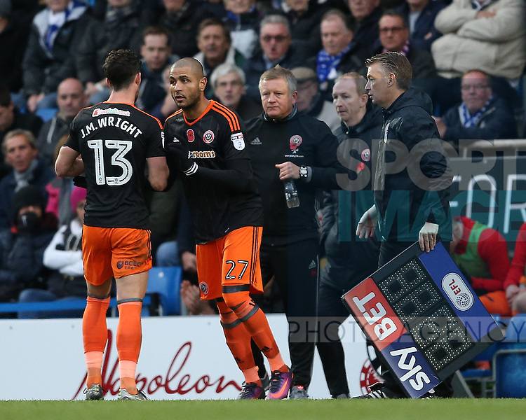 Leon Clarke of Sheffield Utd replaces Jake Wright of Sheffield Utd  during the English League One match at the Proact Stadium, Chesterfield. Picture date: November 13th, 2016. Pic Simon Bellis/Sportimage