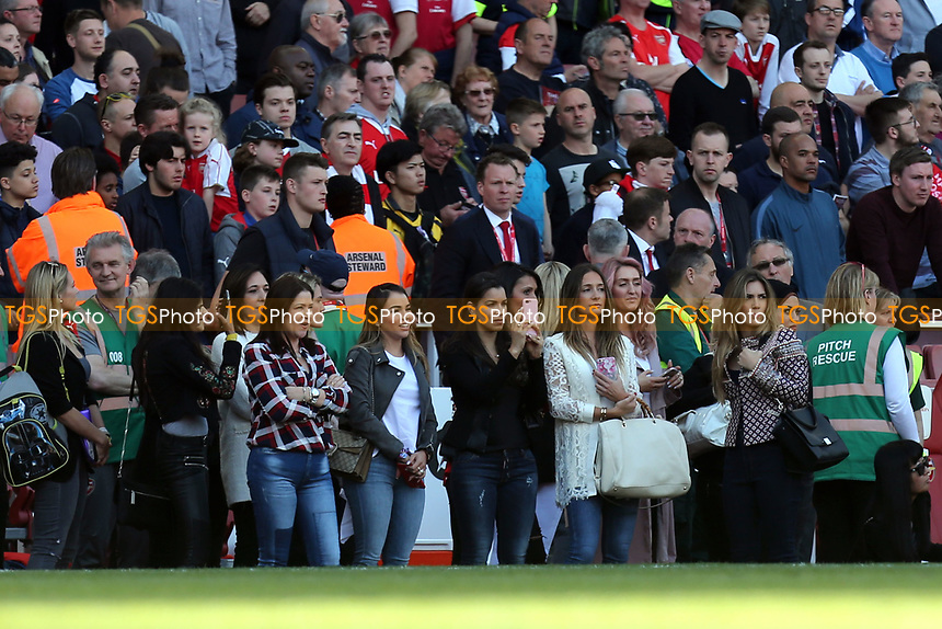 Arsenal players wives and girlfriends watch the team trade around the pitch after Arsenal vs Everton, Premier League Football at the Emirates Stadium on 21st May 2017