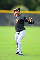 GCL Orioles second baseman Yariel Vargas (11) warms up before a game against the GCL Rays on July 20, 2013 at Charlotte Sports Complex in Port Charlotte, Florida.  GCL Orioles defeated the GCL Rays 4-1.  (Mike Janes/Four Seam Images)