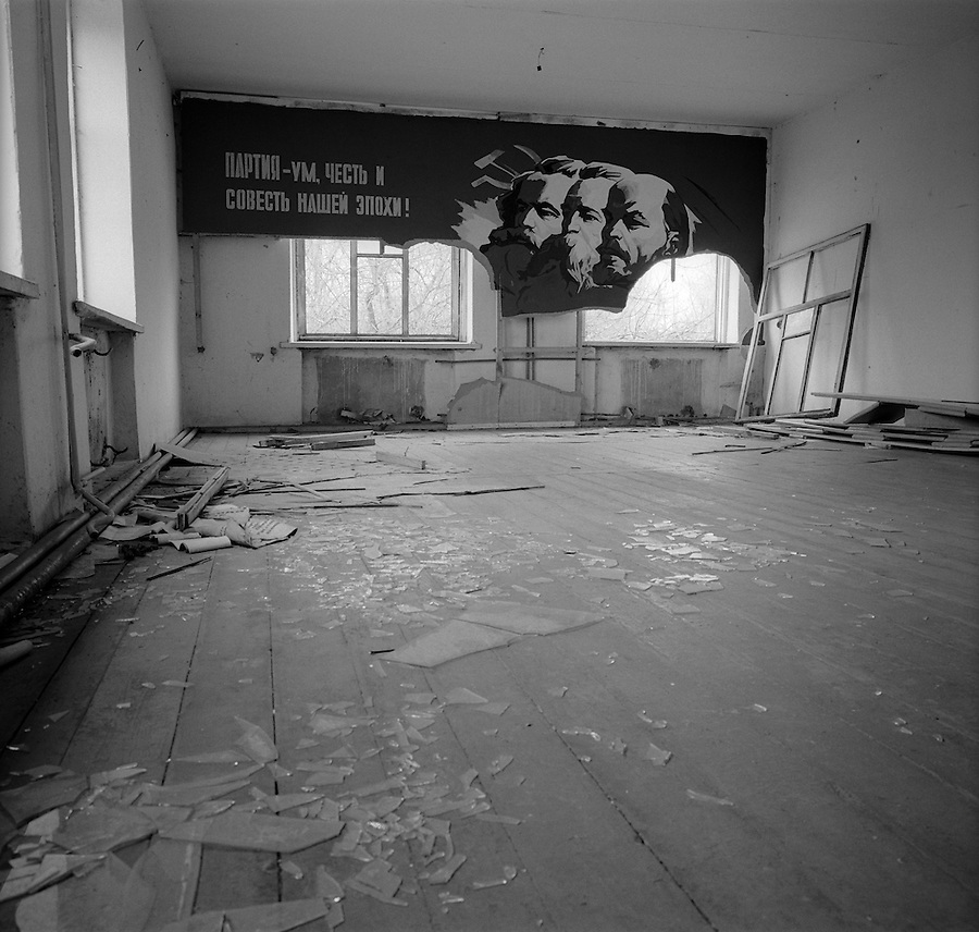 "Chernobyl, Ukraine, Ocober 1995..The explosion at the Chernobyl Nuclear Power Plant on April 26 1986 was the worst nuclear accident in history..Communist symbols in  an abandoned local administrative office. The poster reads ""The Party is the mind, honour and conscience of our epoch""."