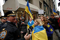 A NYPD officers speaks with protesters while Ukrainian immigrants take part in a protest against war in New York. March 2, 2014. Photo by Eduardo Munoz Alvarez/VIEWpress
