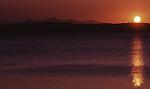 Sunset cases a beam across Lake Towada as it sinks behind the Hachimantai Mountaim Range in Aomori Prefecture on Honshu, Japan. (Jim Bryant Photo).....