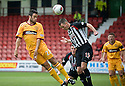 MOTHERWELL'S TIM CLANCY HEADS TOWARDS GOAL