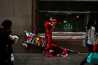 A man disguised as Devil rest after taking part of the Annual Columbus day parade in New York, United States. 08/10/2012. Photo by Eduardo Munoz Alvarez / VIEWpress.