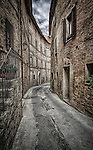 A laneway in the ancient hilltop town of Panicale in Umbria, Italy