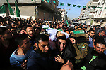 Mourners carry the body of a member of Palestinian security forces loyal to Hamas during his funeral in the central Gaza Strip March 22, 2018. Photo by Ashraf Amra