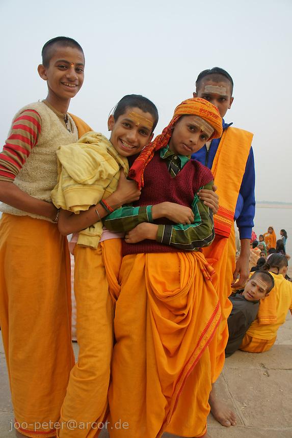 Young Hiindu worshipper at river Ganga in Varanasi
