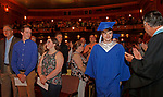 Torrington, CT 062117MK04 Jessie Strickland approaches the stage before hundreds of family and friends as faculty look on during the Lewis Mills High School commencement exercises at the Warner Theatre in Torrington on Wednesday night. Michael Kabelka / Republican-American