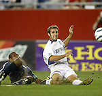04 September 2004: Brian Mullan (right) gets off a second half cross before Avery John (left) can tackle the ball away. The San Jose Earthquakes defeated the New England Revolution 1-0 at Gillette Stadium in Foxboro, MA during a regular season Major League Soccer game..