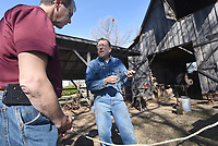 NWA Democrat-Gazette/FLIP PUTTHOFF <br /> BLACKSMITH AT WORK<br /> James Baker, a visitor from Texas, learns Saturday March 18 2017 about tools of the blacksmith trade with Joe Doster of Huntsville during Doster's blacksmithing demonstration at the Shiloh Museum of Ozark History in Springdale. Doster burned coal in his forge and heated metal to red-hot temperatures to make tools and nails during his presentation. He showed an audience some of the items he's made and explained how his tools work.