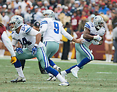 Dallas Cowboys quarterback Tony Romo (9) hands off to running back DeMarco Murray (29) in second quarter action against the Washington Redskins at FedEx Field in Landover, Maryland on Sunday, December 28, 2014.  Tight end James Hanna (84) looks to throw a block at left.<br /> Credit: Ron Sachs / CNP