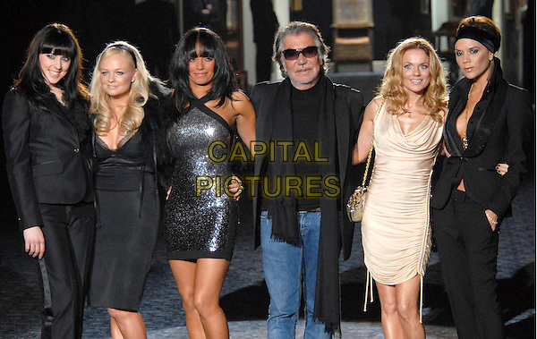 THE SPICE GIRLS - MELANIE CHISHOLM, EMMA BUNTON, MELANIE BROWN, GERI HALLIWELL & VICTORIA BECKHAM & ROBERTO CAVALLI.Roberto Cavalli's MEN'S FASHION SHOW held during Milan Fashion Week, Milan, Italy..January 14th, 2008.full length jeans denim black jacket trousers sparkly dress black trousers suit cream ruched purse bag silver sunglasses shades scarf headscarf hand in pockets sporty baby scary ginger posh cleavage 3/4.CAP/ADM/MR.©Mario Romano/Liverani/AdMedia/Capital Pictures.