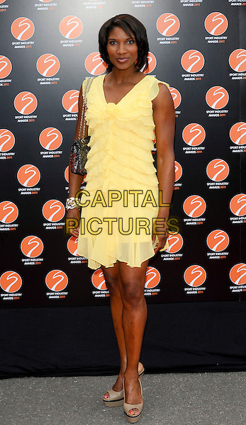 DENISE LEWIS .Attending the Sport Industry Awards, .Battersea Evolution, London, England, UK, May 12th 2011..arrivals full length sleeveless yellow dress ruffles tiered  beige open toe platform shoes  .CAP/CJ.©Chris Joseph/Capital Pictures.