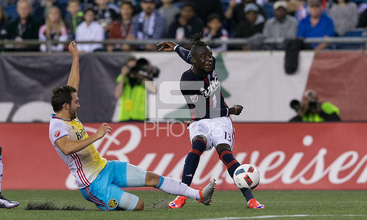 Foxborough, Massachusetts - July 9, 2016: First half action. In a Major League Soccer (MLS) match, the New England Revolution (blue/white) vs Columbus Crew (yellow/white/blue), at Gillette Stadium.