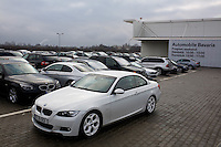 ROMANIA / Bucharest / 16.02.09..Unsold BMW vehicles sit on the forecourt of a BMW dealership in Bucharest. Romania, which had the fastest-growing economy in the EU in the third quarter of last year, predicts a sharp slowdown this year that will lower budget revenue. The IMF said this month that the country probably faces a recession in 2009...© Davin Ellicson / Anzenberger