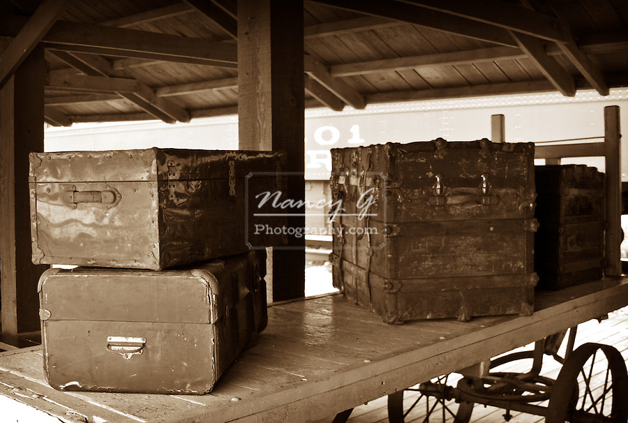 Old Luggage on a train depot platform