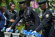 May 10, 2013  (Washington, DC)  Federal Protective Service Police officers dedicate flowers to fallen officers during a ceremony at the Washington Area Law Enforcement Memorial.  (Photo by Don Baxter/Media Images International)