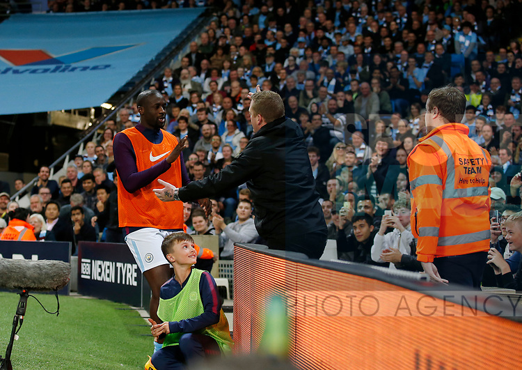 Yaya Toure of Manchester City goes to high five a fan during the Premier League match at the Eithad Stadium, Manchester. Picture date 21st August 2017. Picture credit should read: Simon Bellis/Sportimage