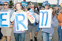 Supporters of Democratic presidential candidate and Vermont senator Bernie Sanders march in the Labor Day Parade in Milford, New Hampshire, on Mon., September 2, 2019. Candidates Bernie Sanders and Vermin Supreme were the only candidates who marched in the parade this year.