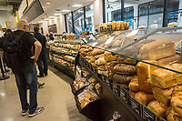Shoppers in the bakery in the new Whole Foods Market in Newark, NJ on opening day Wednesday, March 1, 2017. The store is the chain's 17th store to open in New Jersey. The 29,000 square foot store located in the redeveloped former Hahne & Co. department store building is seen as a harbinger of the revitalization of Newark which never fully recovered from the riots in the 1960's.  (© Richard B. Levine)