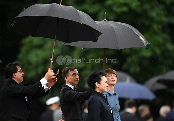 Elke Buedenbender (R), the wife of the German president Frank-Walter Steinmeier, and Peng Liyuan (2-R), the wife of the Chinese president Xi Jinping, during a military reception ceremony in the gardens of the Bellevue Palace in Berlin, Germany, 5 July 2017. The Chinese president is visiting Berlin ahead of the G20 summit in Hamburg (7-8 July 2017). Photo: Ralf Hirschberger/dpa-Zentralbild/dpa /MediaPunch ***FOR USA ONLY***