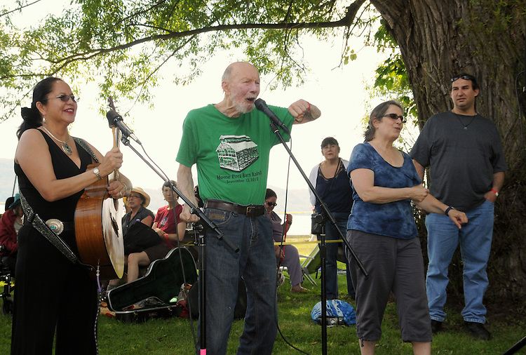 Festival Founder, Pete Seeger, delivering a message in song and story, at the Blessing of the River Ceremony, held along the bank of the Hudson River, on the first day of the Clearwater's Great Hudson River Revival Festival 2013, held at Croton Point Park, in Croton-on-Hudson, NY, June 15, 2013. Photo by Jim Peppler. Copyright Jim Peppler 2013 all rights reserved.