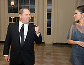 File photo showing Harvey Weinstein and his wife, Georgina Chapman, as they arrive for the Official Dinner in honor of Prime Minister David Cameron of Great Britain and his wife, Samantha, at the White House in Washington, D.C. on Tuesday, March 14, 2012.  Chapman announced on October 10, 2017 that she was leaving her husband as his involvement in a sex scandal deepens.<br />