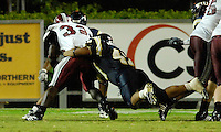 Florida International University Golden Panthers (0-5, 0-1 SBC)  versus the Troy University Trojans (3-2, 2-0 SBC) at the Orange Bowl, Miami, Florida on Saturday, October 6, 2007.  The Trojans defeated the Golden Panthers, 34-16...FIU sophomore linebacker Mannie Wellington (47) (Ponte Vedra, Fla.) dives after Troy running back DuJuan Harris (32).