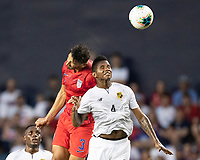 KANSAS CITY, KS - JUNE 26: Omar Gonzalez #3 and Fidel Escobar #4 challenge for a header during a game between United States and Panama at Children's Mercy Park on June 26, 2019 in Kansas City, Kansas.