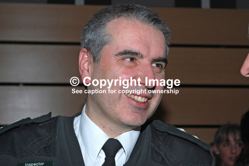 Inspector Robin Dempsey, Police Service of N Ireland, UK, taken at Bobbie Hanvey photo exhibition in Down Arts Centre, Downpatrick, Co Down. 201201205722..Copyright Image from Victor Patterson, 54 Dorchester Park, Belfast, United Kingdom, UK...For my Terms and Conditions of Use go to http://www.victorpatterson.com/Victor_Patterson/Terms_%26_Conditions.html