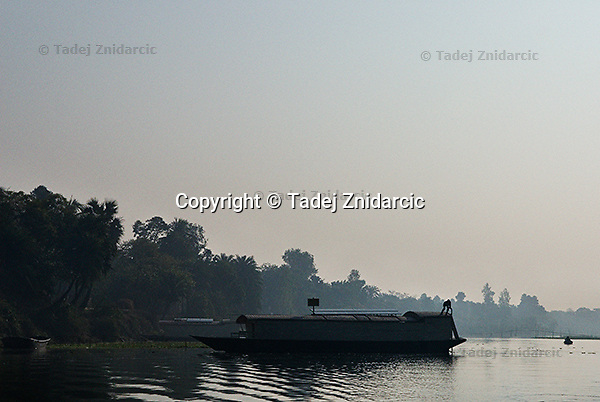 Skipper steers a school boat towards the shore on the Atrai river in the morning. (Photo by Tadej Znidarcic)