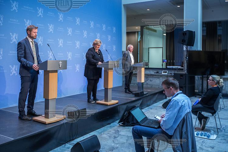Press conference with Prime Minister Erna Solberg and Minister of Health Bent Høie  (left) to present the Corona commission, led by Stener Kvinnsland (right). <br /> <br /> The Corona commission is set up to evaluate the Norwegian response to the crisis. <br /> <br /> Norwegian authorites introduced strict measures to combat the Coronavirus (COVID-19) in March 2020. <br /> <br /> <br /> ©Fredrik Naumann/Felix Features<br /> <br /> <br /> Pressekonferanse om koronakrisen og den nyoppnevnte Koronakommisjonen<br /> Statsminister Erna Solberg og helse- og omsorgsminister Bent Høie inviterer til pressekonferanse sammen med lederen for den nyoppnevnte Koronakommisjonen, Stener Kvinnsland.