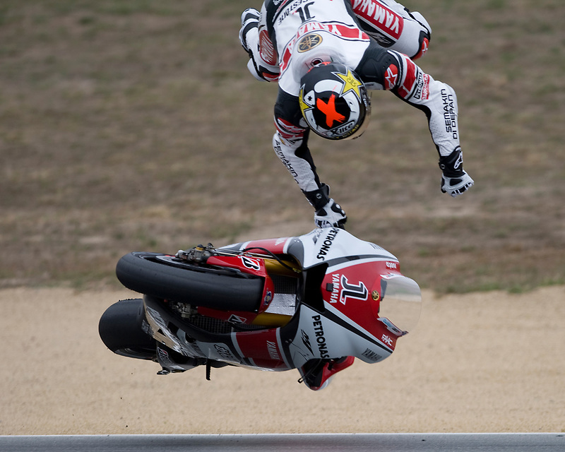 2010 World Champion Jorge Lorenzo takes a high-side crash on his Yamaha M1 at turn 5 during Saturday morning practice at the 2011 Red Bull U.S. Moto Grand Prix at Mazda Raceway Laguna Seca. Lorenzo qualified in pole position that afternoon and finished the race in second the next day.