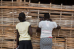 Mcc0075406 . Daily Telegraph<br /> <br /> DT Foreign<br /> <br /> Two young women look through the wicker slats of a classroom supported by UNICEF .<br /> <br /> <br /> Children in POC 3 , the Protection of Civilian Camp inside the vast UN compound on the outskirts of Juba . Over 20,000 civilians who predominantly fled from conflict in the equatorial states of South Sudan . United Nation's agencies recently announced a famine in the war torn country .<br /> <br /> Juba 27 February 2017