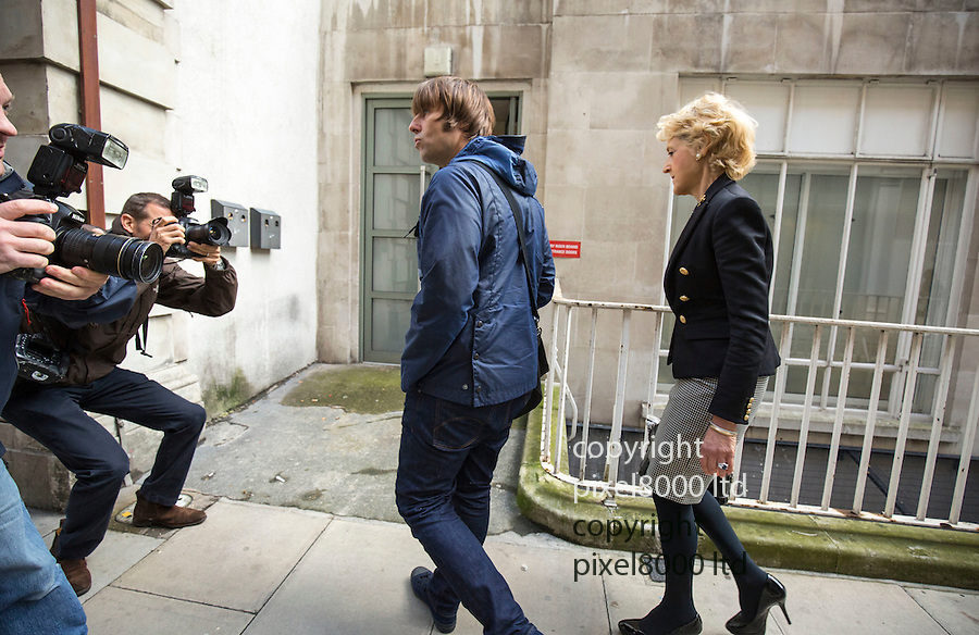 Pic shows: Liam Gallagher - with Fiona Shackleton<br /> <br /> <br /> Former Oasis singer Liam Gallagher today arrived at court alongside one of the country's top divorce lawyers.<br /> The 42-year-old musician, who is embroiled in a legal battle with his ex-wife Nicole Appleton, was seen outside the Central Family Court in London with Fiona Shackleton.<br /> Baroness Shackleton, a relative of Nigella Lawson, represented Prince Charles in his 1996 divorce from Princess Diana and Sir Paul McCartney in his 2008 divorce from Heather Mills. <br /> <br /> <br /> <br /> <br /> <br /> <br /> <br /> Pic by Gavin Rodgers/Pixel 8000 Ltd  17.9.15