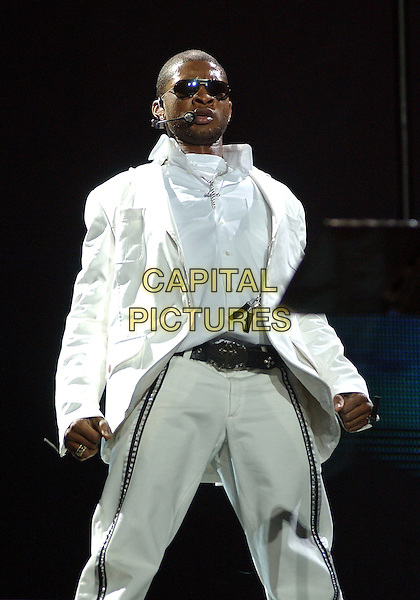 USHER.Performs during a tour stop on his 'The Truth Tour' held at Mellon Arena..October 7th, 2004.stage, concert, live, music, gig, singing, half length, white suit jacket, dancing, sunglasses, shades, striped trousers.www.capitalpictures.com.sales@capitalpictures.com.© Capital Pictures.