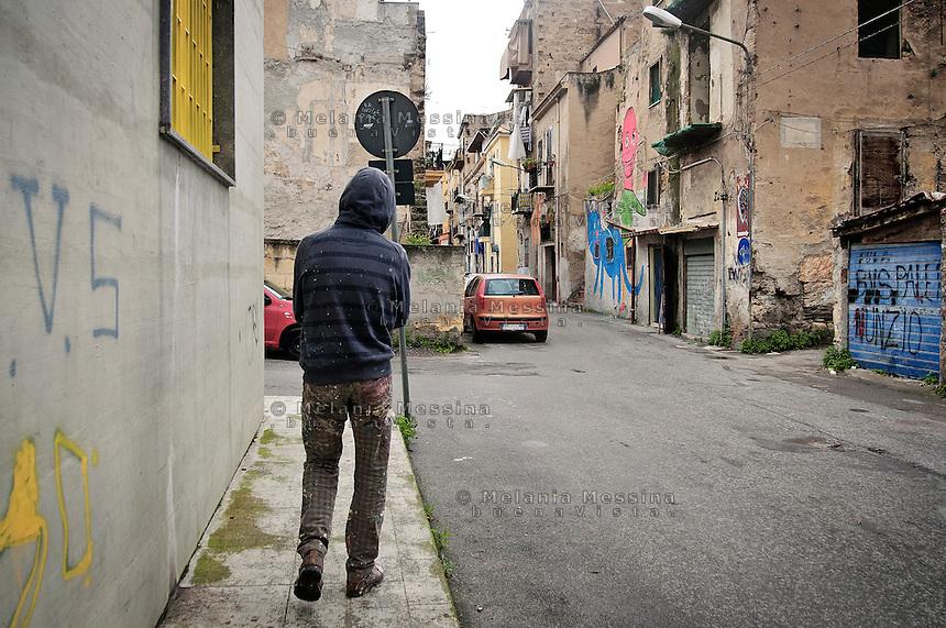 The street artist &quot;EMA JONS&quot; walking in Borgo Vecchio.<br /> Ema Jons street artist in Borgo vecchio, Palermo