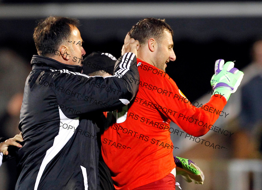 BELGRADE, SERBIA - SEPTEMBER 20. Goalkeeper Sasa Stamenkovic of Azerbaijan's Neftchi PFK (R) argues with the FK Partizan's Darko Belojevic (L) after the UEFA Europa League Group H match between FC Partizan and FC Neftci at Partizan stadium in Belgrade, Serbia on Thursday, September 20, 2012. (Photo by Srdjan Stevanovic/Getty Images)
