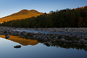 Black Mountain from along the East Branch of the Pemigewasset River in Lincoln, New Hampshire during the autumn months.