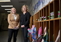 NWA Democrat-Gazette/BEN GOFF -- 02/12/15 Laurel Jackson (right), president of the Rogers Public Education Foundation Board, and Rachel Harris, vice president of the Rogers Public Education Foundation Board, pose for a photo at Tillery Elementary in Rogers on Thursday, Feb. 12, 2015.
