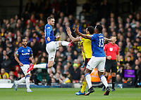 1st February 2020; Vicarage Road, Watford, Hertfordshire, England; English Premier League Football, Watford versus Everton; Gylfi Sigurosson of Everton leaps in the air to kick the ball from Troy Deeney of Watford chest with Yerry Mina of Everton marking the Watford captain