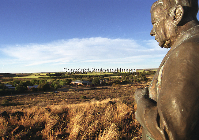 """dicuafr00039. Culture Afrikaaner. South African Landscapes; Northern Cape; Orania.. A statue of Dr. Hendrik Frensch Verwoerd overlooks the town of Orania on the Orange River in the Northern Cape. Afrikaner supporters of the Freedom Front, looking for their own cultural """"homeland"""" have made this town, a town formerly used as construction camp for builders of the irrigation scheme, their home. .DATE: November 2003..©Pieter Malan/iAfrika Photos"""