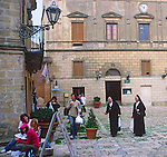 Two roman catholic nuns in the main square, Erice, Sicily, Italy