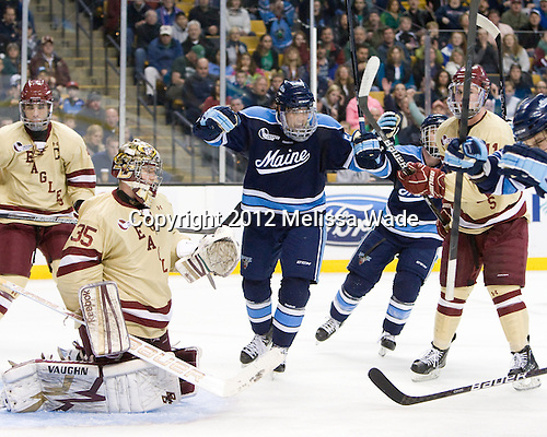 Matt Mangene (Maine - 57) celebrates Flynn's goal. - The Boston College Eagles defeated the University of Maine Black Bears 4-1 to win the 2012 Hockey East championship on Saturday, March 17, 2012, at TD Garden in Boston, Massachusetts.