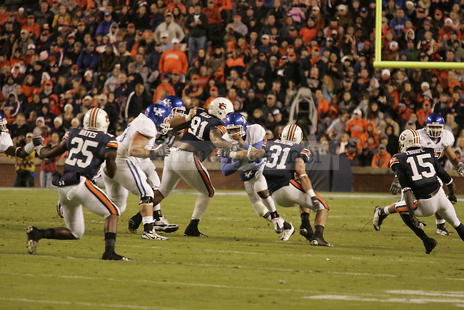 UK quarterback Morgan Newton runs for some yards in the first half of the game against Auburn at the Jordan-Hare Stadium Saturday..Photo by Zach Brake | Staff