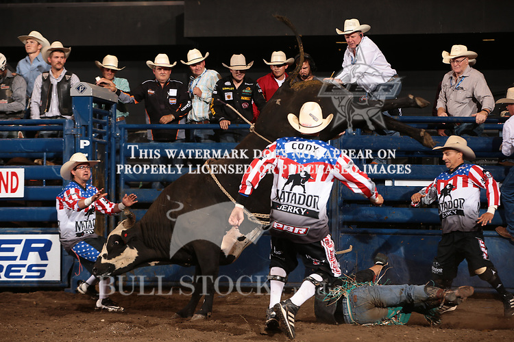 Brant Atwood attempts to ride Dakota Rodeo/chad Berger/Clay Struve/H&C Bucking Bulls's Thunderbolt during the second round of the Bismarck Real Time Pain Relief Velocity tour PBR. Photo by Andy Watson