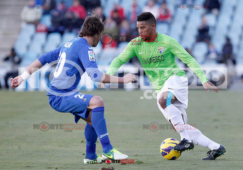 Getafe's Juan Valera (l) and Malaga's Eliseu Pereira during La Liga match.December 01,2012. (ALTERPHOTOS/Acero) ©/NortePhoto