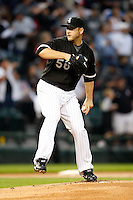 August 7, 2009:  Pitcher Mark Buehrle (56) of the Chicago White Sox delivers a pitch during a game vs. the Cleveland Indians at U.S. Cellular Field in Chicago, IL.  The Indians defeated the White Sox 6-2.  Photo By Mike Janes/Four Seam Images
